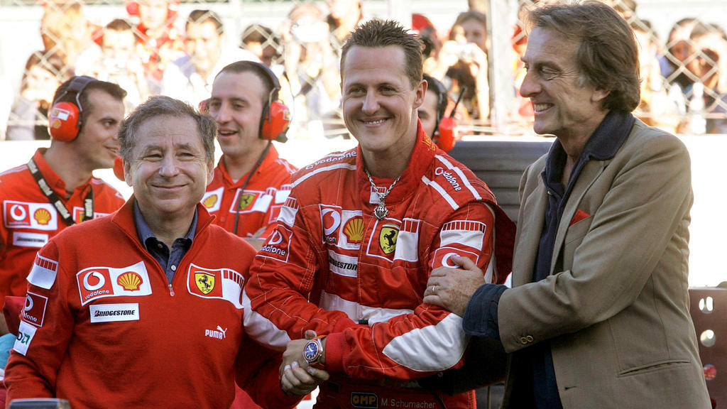 FILE - German Formula One driver Michael Schumacher (C) stands amidst managing director of Ferrari Jean Todt (L) and team's president Luca Cordero di Montezemolo in Monza on Sunday 29 October 2006 during the Ferrari Days, the traditional event organi