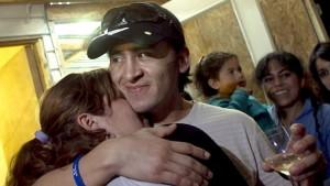 Chilean miner Ariel Ticona hugs his wife, Elizabeth Segovia, as he arrives to his home after leaving the Copiapo's Hospital in Copiapo, Chile, after being discharged by the medical institution on 15 October 2010. Gomez was one of the 33 miners who we