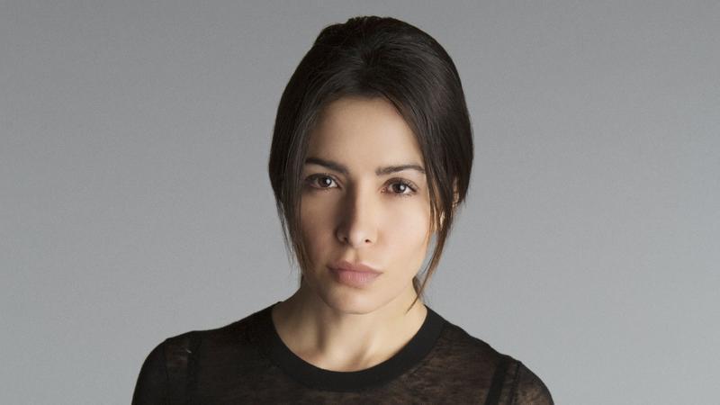 Sam Shaw (Sarah Shahi)