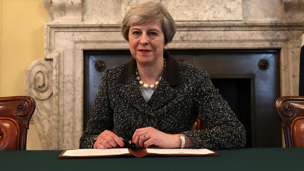 British Prime Minister Theresa May in the cabinet office signs the official letter to European Council President Donald Tusk invoking Article 50 and the United Kingdom's intention to leave the EU on March 28, 2017 in London, England. After holding a