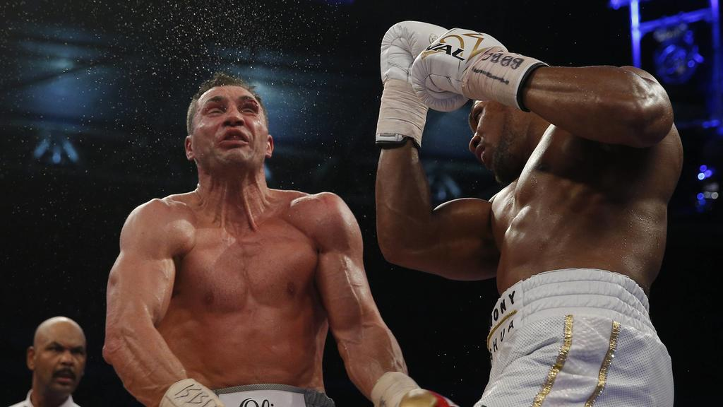 Britain Boxing - Anthony Joshua v Wladimir Klitschko IBF, IBO & WBA Super World Heavyweight Title s - Wembley Stadium, London, England - 29/4/17 Anthony Joshua in action with Wladimir Klitschko BOXE : Anthony Joshua vs Wladimir Klitschko - Wembley -