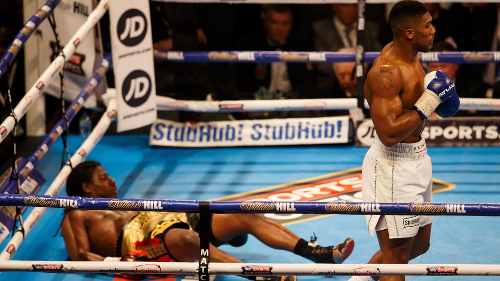 ANTHONY JOSHUA knocks CHARLES MARTIN to the floor during the IBF World Heavyweight title at the O2 Arena, London on April 9th 2016 / Boxing - Martin v Joshua - 9/4/2016 Boxing - IBF Heavyweight Championship - Charles Martin v Anthony Joshua O2 Arena,