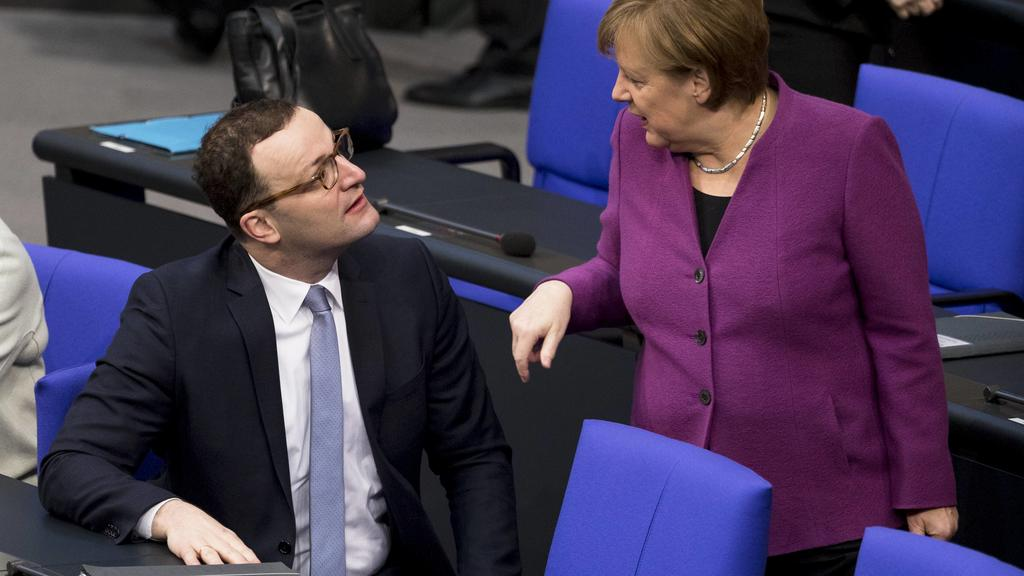 February 22, 2018 - Berlin, Germany - German Chancellor Angela Merkel (R) speaks with Jens Spahn (L) as she arrives to the 14. plenary session at Bundestag (lower house of parliament) in Berlin, Germany on February 22, 2018. Berlin Germany PUBLICATIO
